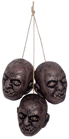 "The hanging shrunken head trio is one of the best value props around. Each head measures 6"" from top to bottom and is well detailed. Comes with rope for hanging. Perfect for Halloween parties with a pirate or voodoo theme"