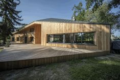 Image 7 of 20 from gallery of CWA House / Beczak / Beczak / Architekci. Photograph by Jan Karol Gołębiewski Exterior Design, Interior And Exterior, Wooden Facade, Architectural Materials, Freestanding Fireplace, Roof Trusses, Amazing Buildings, Eco Friendly House, Modern Architecture