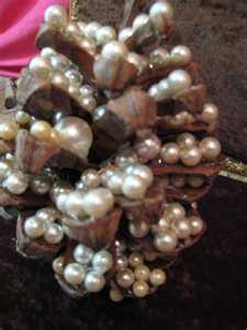"""used pearls on my large pine cone to create a """"tree"""""""