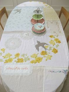 Upcycle idea: try this patchwork tablecloth with different shades of lace curtains and fuse backing to a piece of darker lace and cut out and iron on bird shapes, lovely!