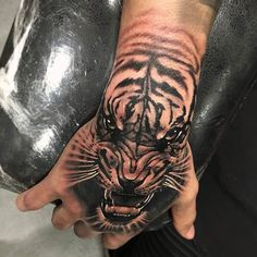 Tiger Hand tattoo by @cris_saketattoocrew at @saketattoocrew in Athens, Greece #cris_saketattoocrew #crissaketattoocrew #criskazantzis #saketattoocrew #athens #greece #tiger #tigertattoo #handtattoo...
