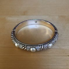 Brighton bracelet Silver bangle with magnetic closure. Pearl stone decorate the front Brighton Jewelry Bracelets