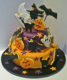 Halloween cake by Maria Claire Cranston. Pumpkins, black cats, ghouls and ghosts are all represented on this colourful, Halloween-themed cake.