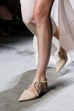 Nude strappy flats.