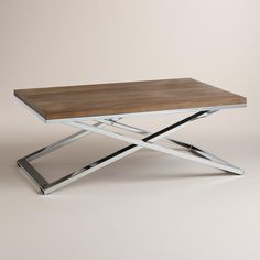 With a chrome X-base and a distressed wood surface, our coffee table marries contemporary design with rustic warmth.