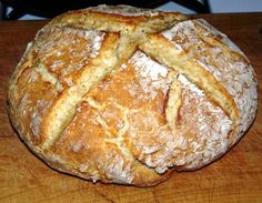 """Authentic Irish Soda Bread recipe using only four ingredients. Note: Traditional Irish Soda Bread does not have raisins or sugar; it was basic bread that the peasants ate with every meal. The bread with the raisins and sugar is dessert bread reserved for special occasions and it is called """"Spotted Dog"""" or """"Railway Cake."""""""