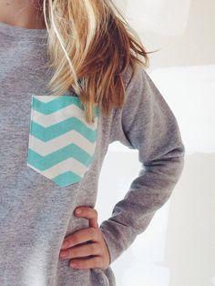 chevron pocket crewneck sweatshirt via knitvie on Etsy - $25.00......Or I could just sew my own chevron pocket on a shirt?!?
