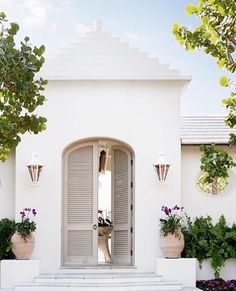 Everything about this entrance is gorgeous and I love the color of the doors.