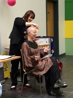 Brave IT Technician Emma Carroll had her head shaved today for charity in the covered courtyard at West Notts College.