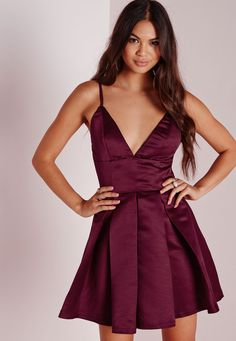 Ensure you have that standout silhouette this season in this chic burgundy skater dress. Featuring a fierce structured bodice with plunging neckline this satin head turner is a must-have. Team with strappy black heels and box clutch for a t...
