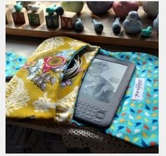 Ereader pouch inspiration photo. It has a pocket for cables!