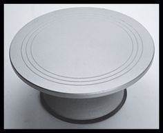 Professional Cake Decorating Turntable by Fat Daddios