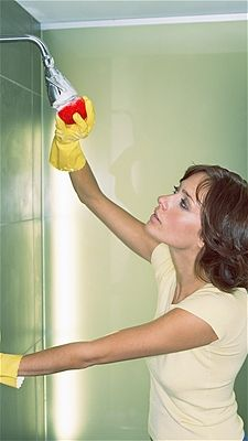 Prevent soap scum from forming by spraying bathtub walls, shower doors and curtains with shower spray or white vinegar, which will cut through soap residue. To shed water and avoid build-up, rub tiles and tub surrounds with lemon oil, baby oil, or car or boat wax