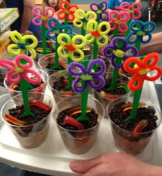 oreo and gummy worm dirt cups with flowers | ... loved them. And even the boys wanted to keep their flower spoons