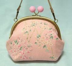 桜色の、ちりめん風生地で、あめ玉がま口・ミニバッグを製作しました♪桜の生地に、桜色のあめ玉が、お花見にもぴったりです^^ お着物にも、お洋服にも、とっても可愛...|ハンドメイド、手作り、手仕事品の通販・販売・購入ならCreema。