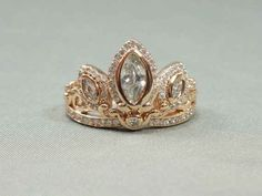 This Rapunzel tiara ring:
