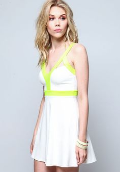 Neon green stripes on white dress, peachy makeup