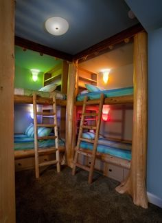 Multiple Kids Bedroom - Create a functional alcove and place floor to ceiling bookshelves behind bunk beds. Give kids the option to choose their own personal lighting colors and they'll each have their own secluded personal space.