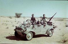 German soldiers out hunting using their VW Type 82 kübelwagen.