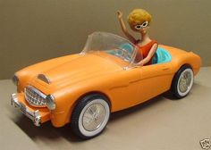 Original vintage 1962 Barbie with her bright orange Austin Healy. It may be plastic, but it's affordable!
