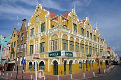 Here, the famous Penha building in Willemstad, Curacao. Built in in the. Kingdom Of The Netherlands, Willemstad, Slums, 18th Century, Caribbean, The Neighbourhood, Photo Galleries, Around The Worlds, Island