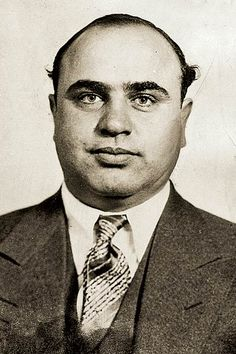 """Al"" Capone takes a mug shot in 1931. Capone's full name was Alphonse Gabriel Capone. He was an American gangster from the 1920's to 1031. He was popular for smuggling and bootlegging liquor during the Prohibition era. In this picture Capone was convicted on federal charges of tax evasion and sentenced to federal prison."
