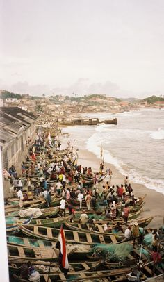 The Door of No Return - The site for the slave fort at Cape Coast, Ghana, was selected because a reef provides a natural harbor. Large ships can anchor just offshore. I didn't know this as I walked through the doors to find, not a somber reminder of past atrocities, but a scene bursting with life; scores of Ghanaian fishermen use the same harbor today as a place to launch their boats.