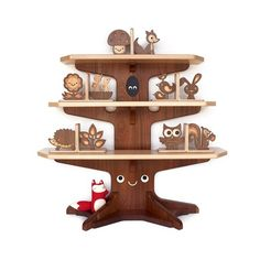 This charming heirloom furniture piece has been designed and handmade in our Graphic Spaces family wood shop (not really in a cute forest by gnomes and fairies... hehe). Our tree bookshelf is possibly the most cr...