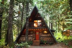 With a s'mores-ready fire pit and outdoor tub under the evergreens, this woodsy cabin was meant for soaking in summer's moments. Cabins In The Woods, House In The Woods, Stone Cabin, Outdoor Tub, Forest Cabin, A Frame House, Cabins And Cottages, Cabin Homes, House Design