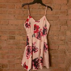 New Light Pink Floral Backless Dress Brand new! Its a satin material. Bust 88cm, waist 70cm, length 83cm :) Dresses Mini