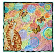"""Curious Cat"" by Nita Markos.  Alliance for American Quilts. Twenty circles were collaged onto the background and covered with tulle before quilting."