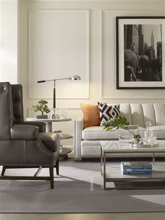 Vanguard Furniture: Living room with accents of orange and black with leather wing chair