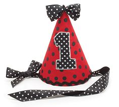 "Cone shaped party hat covered in red with black polka dots fabric, with a ""1"" in black with white polka dots appliqued on the front.  Black satin ribbon with white polka dots attached to the sides to tie the hat onto the child's head.  7"" H x 4 1/2"" Diameter.  1 set of 8."