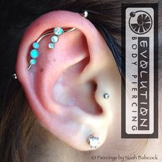 Fresh industrial piercing with #opal and #titanium jewelry by anatometal (at Evolution Body Piercing)