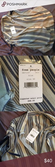FREE PEOPLE Free People fashion tee, size XS but runs big. Ties at the shoulders making it fun to layer! Brand new Free People Tops Button Down Shirts