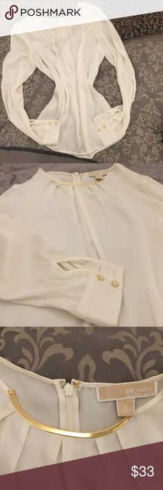 Michael Kors blouse. 100% Authentic, flowy, gorgeous top, gold metal around collar bone, can wear it with leggings because it covers the butt, comfy, small stain on bottom of sleeve as seen in the last picture. Stain looks removable. Michael Kors Tops Blouses