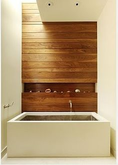 Love how the wood wall gives this bath a soft natural feeling