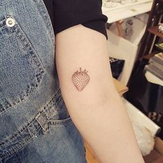 Hand poked strawberry tattoo for Amy.