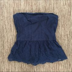 Dark Blue Strapless Peplum Top w/ Lace Dark blue strapless peplum top with lace on bottom ... Never before worn! (Size medium fits like a small though) Hollister Tops