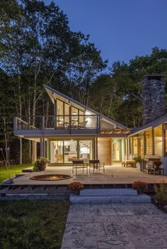 The Marvin Architects Challenge Best in Show winner is radiant at night. William M. Hanley used Marvin windows to complement the native Maine wood inside and outside of this home. Photo by Brian Vanden Brink.