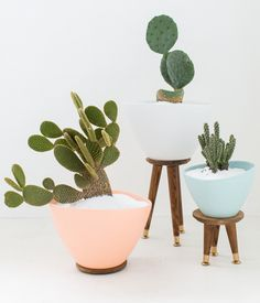 Some Mid-Century vibes and a few inexpensive materials are all you need to transform basic IKEA planters into cool tripod containers.