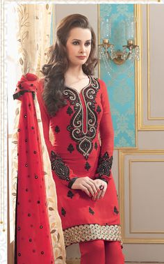 This brilliant array will make you the ultimate classic beauty at the next event you attend. Look stunningly beautiful in this Scintillating Red Faux Georgette Salwar Kameez. Beautified & stylized with lace work to give you an attractive look.