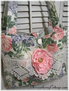 Adding a solid color fabric flower to match the floral print is perfect on top of the lace trim to make this bag so special.