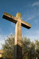 A wooden cross conveys historical and symbolic aspects of the Christian life.
