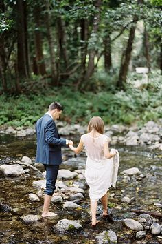We love how this Big Sur wedding photo captures the trust between these adventurous newlyweds as they guide each other through a rocky riverbed.