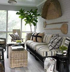 soothing neutrals on a lovely screened porch w/ ceramic tile floor & painted brick wall - via Mix and Chic