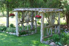 Cedar log arbor.  Welcome to my backyard.  More ways to reuse fallen cedars.  DIY, I did!
