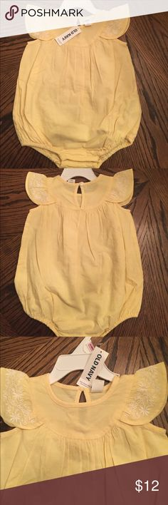 NWT Baby girl old navy bubble romper 6-12. Brand new yellow bubble romper for baby girl. White eyelet design on designed sleeves. Snap for easy diaper change or access. Pleated at chest. 6-12 months. Old Navy One Pieces Bodysuits