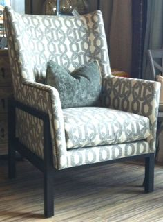 this lovely highback accent chair features a black walnut wood base curved