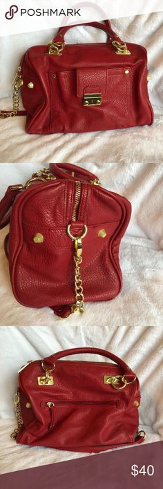 Olivia & Joy Red Purse and fabulous golden details Olivia & Joy make fabulous purses with attention to detail.  This purse has fabulous golden snaps, taps, shoulder straps and connectors on the hand straps.   This purse was only carried twice to the best of my recollection.  It is in pristine condition and photos reveal the use but no damage.  There is minor use and wear on this purse, but no rips on inside pockets.  The details on this purse set it off and make your look classy and very…